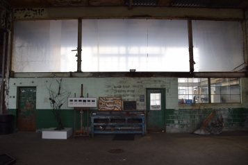 The abandoned warehouses make perfect spaces for art. Here we are inside a dark but beautiful artist studio.