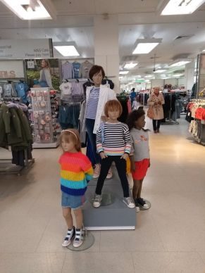 Colourful kidswear display, focused on jumpers and coats
