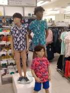 Boy mannequins showcasing short and pattern shirt combo on trend